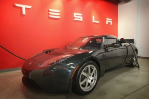 A Tesla Roadster Sport sits in a Chicago dealership showroom in 2011. (Scott Olson/Getty)