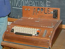 The Apple I, Apple's first product, was sold as an assembled circuit board and lacked basic features such as a keyboard, monitor, and case. The owner of this unit added a keyboard and a wooden case