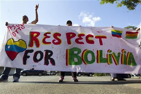Supporters of Bolivia's President Evo Morales shout slogans in front of the Bolivian embassy in Caracas