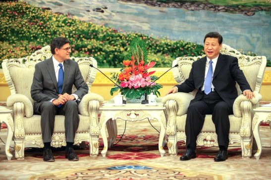 U.S. Treasury Secretary Lew speaks with China's President Xi Jinping during their meeting at the Great Hall of the People in Beijing on March 19, 2013. The Committee on Foreign Investment in the United States (CFIUS) is an inter-agency committee, including the Dept. of Treasury.