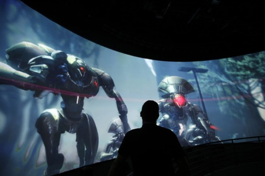 "Alex Beckers watches a presentation on the video game ""Destiny"" at the Activision Blizzard Booth during the Electronic Entertainment Expo in Los Angeles."