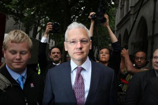 WikiLeaks founder Julian Assange arrives at the High Court on July 13, 2011, in London. At left is Sigurdur Thordarson. Photo by Peter Macdiarmid/Getty Images