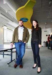 Standing underneath a giant banana fixture left behind by a prior tenant, Hearsay Social co-founders Steve Garrity and Clara Shih, talk at their company headquarters on Monday, June 22, 2013 in San Francisco, Calif. Hearsay Social helps big brand businesses connect with their customers on social networks like Facebook and Twitter. (Karl Mondon/Bay Area News Group
