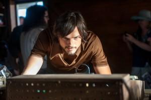 Ashton Kutcher portraying Steve Jobs